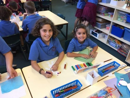 Kindy student with their Year 4 buddy.